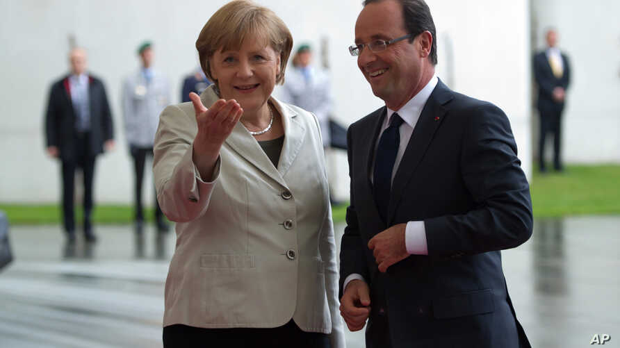 German Chancellor Angela Merkel welcomes French President Francois Hollande at the chancellery in Berlin, Germany, May 15, 2012.