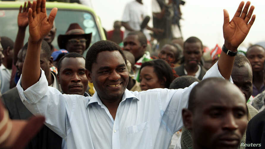 Hakainde Hichilema, United Democratic Alliance (UDA) leader and presidential candidate for Zambia's upcoming elections, greets his supporters at Zingalume compound in Lusaka, September 26, 2006.