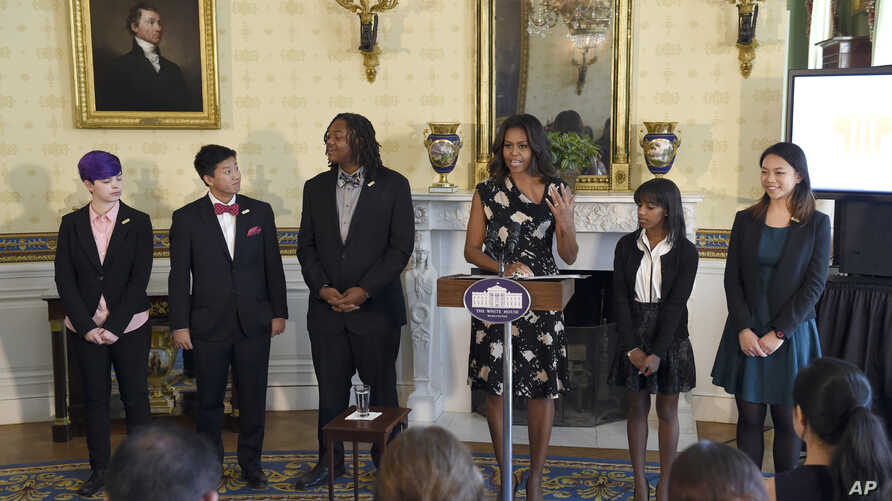 First lady Michelle Obama speaks in Blue Room of the White House in Washington, Thursday, Oct. 8, 2015, during an event to honor the 2015 class of the National Student Poets Program (NSPP), the nation's highest honor for youth poets.