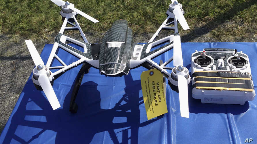 FILE - An Aug. 2015 photo of Yuneec Typhoon drone and controller in Jessup, Maryland, where State Police and prison officials say two men planned to use the drone to smuggle drugs, tobacco and pornography videos into the maximum-security Western Corr