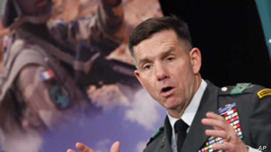 U.S. Lieutenant General William B. Caldwell, head of the NATO Training Mission in Afghanistan, addresses a news conference in Brussels, March 3, 2010.
