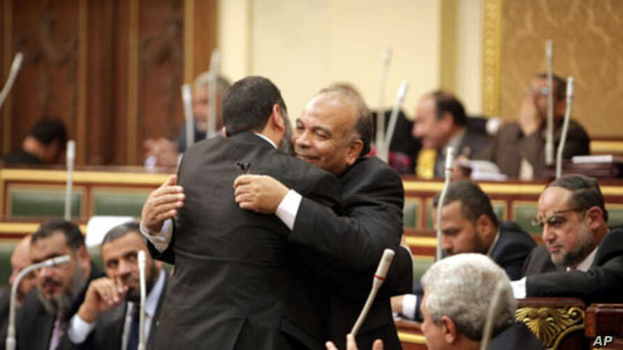 Saad el-Katatni embraces another member of parliament after being nominated by the Freedom and Justice Party for the post of the Parliament speaker, 23 Jan. 2012