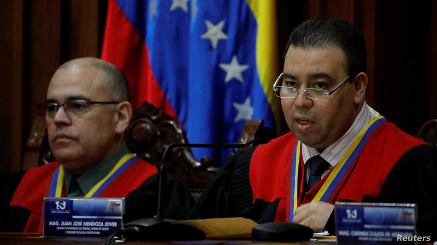 Juan Mendoza, right, Venezuela's Supreme Court second vice president and president of the Constitutional Chamber, seated next to Arcadio Delgado, a member of the of the Constitutional Chamber, gives a news conference in Caracas, Venezuela, July 21, 2