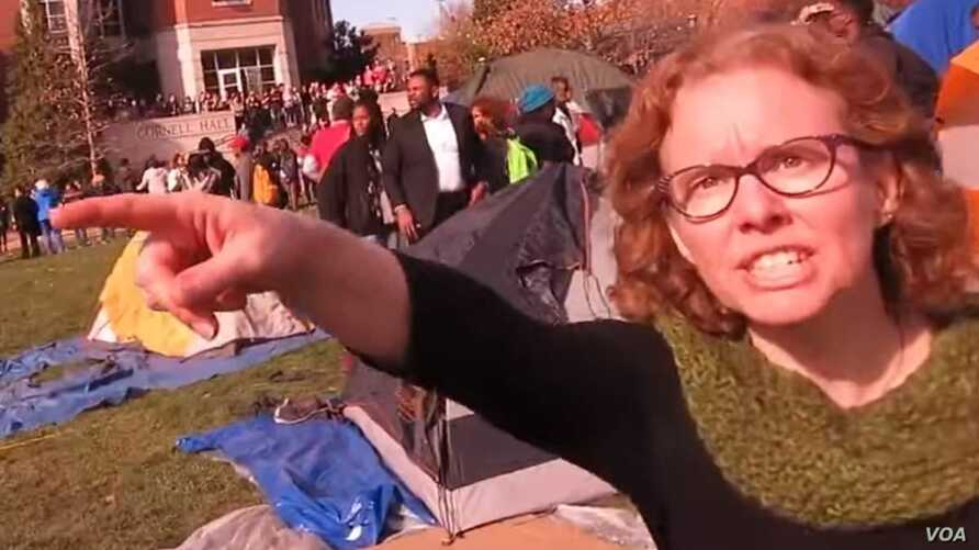 """University of Missouri communications professor Melissa Click is seen in a screenshot from a video shot by University of Missouri student photographer Mark Schierbecker, telling the photographer he """"needs to go"""" and can't videotape the student protes"""