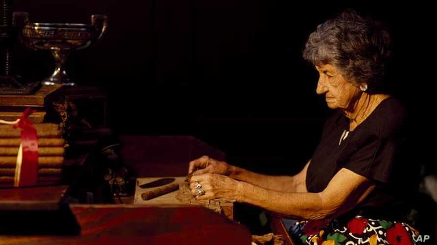 This woman began wrapping tobacco leaves into cigars at 16. In her prime, she produced 400 hand-rolled cigars a day. (Carol M. Highsmith)