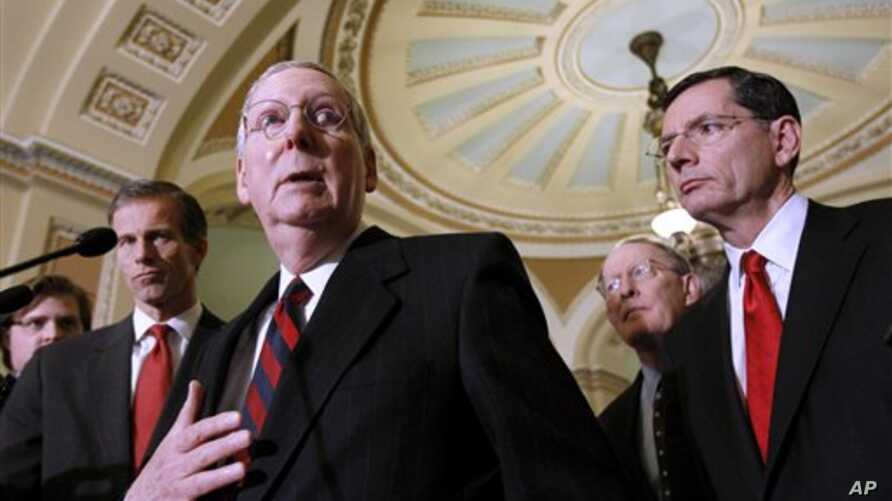 Senate Minority Leader Mitch McConnell of Ky., second from left, gestures during a news conference on Capitol Hill in Washington, Tuesday, Dec. 7, 2010. From left are, Sen. John Thune, R-S.D., McConnell, Sen. Lamar Alexander, R-Tenn., and Sen. John B