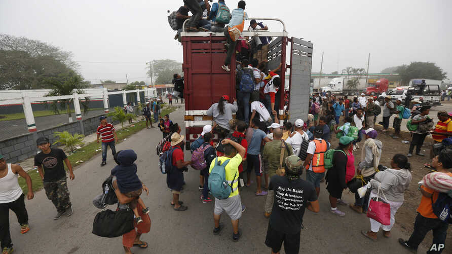 Central American migrants pack into the back of a trailer truck as they begin their morning trek as part of a thousands-strong caravan hoping to reach the U.S. border, in Isla, Veracruz state, Mexico, Nov. 4, 2018.
