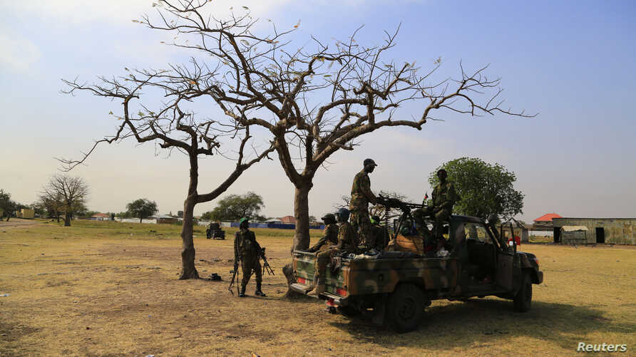 South Sudanese army soldiers are seen guarding Malakal town, 497km (308 miles) northeast of capital Juba, Dec. 30, 2013 after retaking the town from rebel fighters.