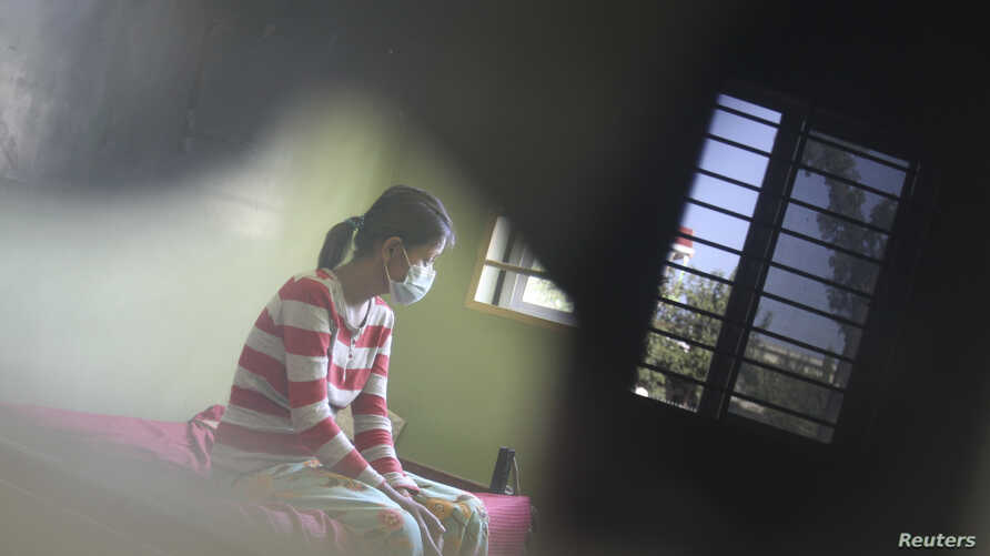 FILE - An HIV-positive patient rests at the Khmer-Soviet Hospital in Phnom Penh, Nov. 29, 2011.