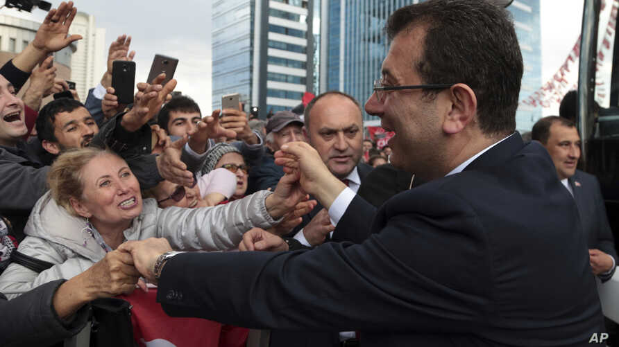 Cheering supporters try to touch Ekrem Imamoglu, the main Turkish opposition's candidate for Istanbul, after he visited the mausoleum of Mustafa Kemal Ataturk, the secular republic's founder, in Ankara, Turkey, Tuesday, April 2, 2019.