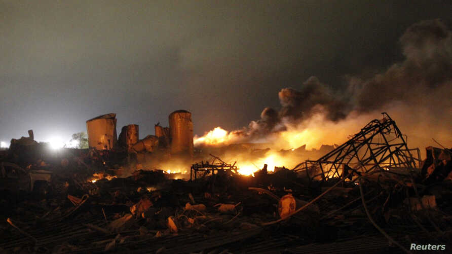 The remains of a fertilizer plant burn after an explosion at the plant in the town of West, near Waco, Texas early April 18, 2013. The deadly explosion ripped through the fertilizer plant, injuring more than 100 people, leveling dozens of homes and d