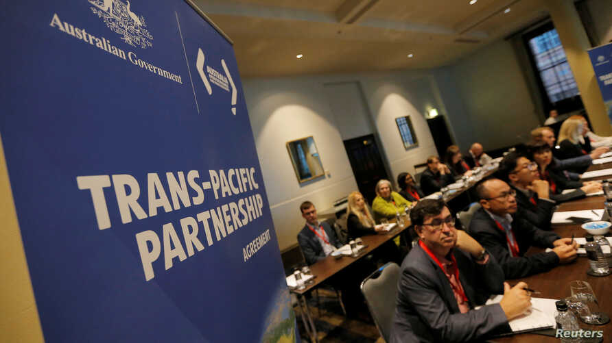 Delegates participate in the opening session of the Trans Pacific Partnership senior leaders meeting in Sydney, Australia, Aug. 28, 2017.