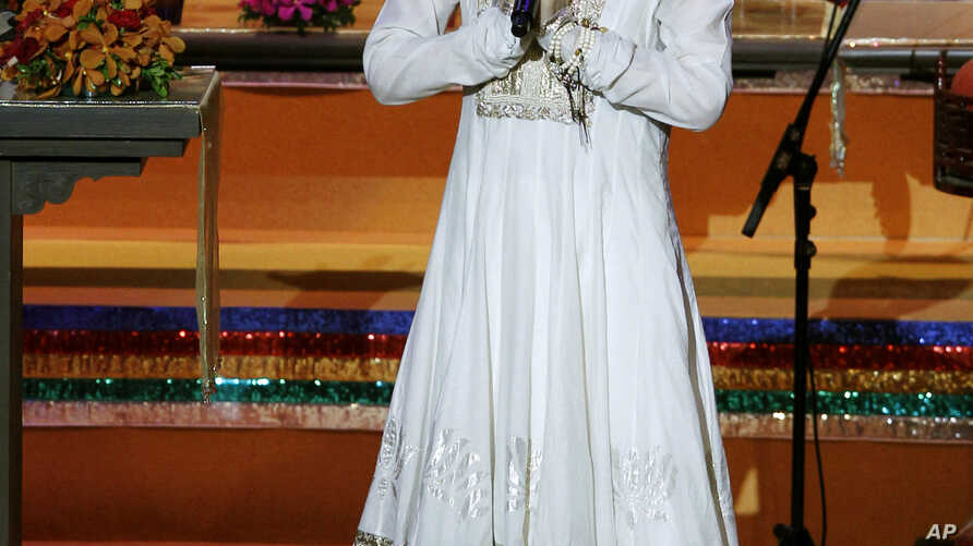 FILE - Chinese pop singer Faye Wong, also known as Wang Fei, performs during the opening ceremony of the third World Buddhist Forum in Hong Kon, April 26, 2012. China's state media have criticized celebrities for attending an event in northern India