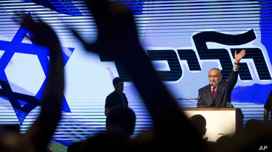 Israel's Prime Minister Benjamin Netanyahu waves during his Likud Party conference in Tel Aviv, Israel, Aug. 9, 2017.