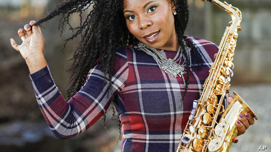 Saxophonist Tia Fuller poses for a photo session in Piscataway, N.J., Jan. 6, 2019.