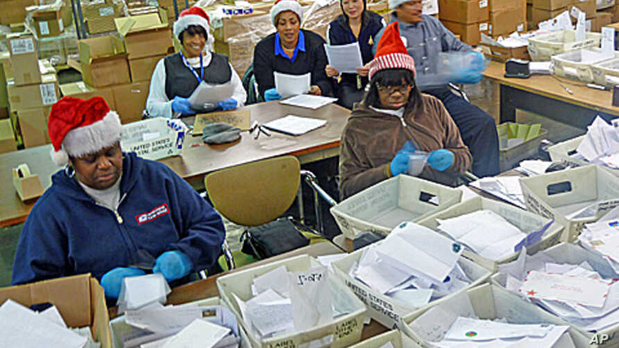 """Some of the 22 postal  """"elves"""" who volunteer to organize letters to Santa and arrange for the public or charities to """"adopt"""" them."""