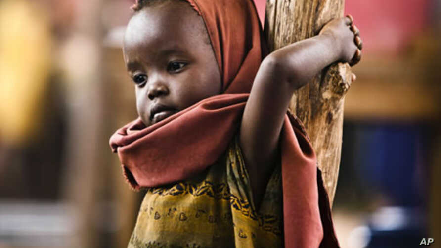 A newly arrived Somali refugee child awaits medical examinations at the Dadaab refugee camp, near the Kenya-Somalia border, July 23, 2011