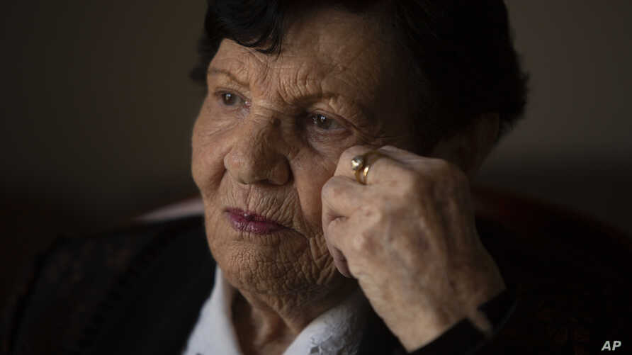 In this Jan. 23, 2019 photo, Holocaust survivor Cipora Feivlovich gives an interview to The Associated Press at her house in Jerusalem.
