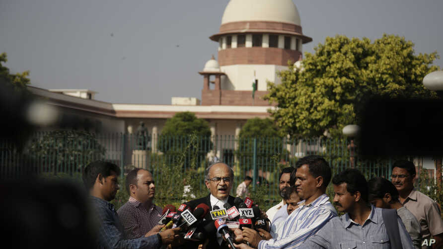Indian attorney Prashant Bhushan briefs media persons at the Supreme Court premises in New Delhi, India, Friday, Oct. 13, 2017.