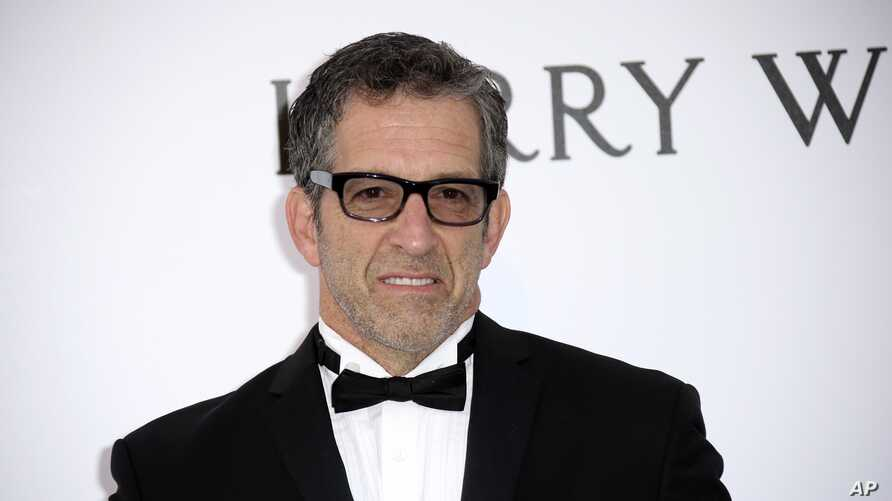 FILE - Designer Kenneth Cole, pictured at the amfAR Cinema Against AIDS benefit at the Cannes international film festival, May 19, 2016, was one of the first celebrities to speak out publicly about HIV, which hit the fashion industry hard in the 1980