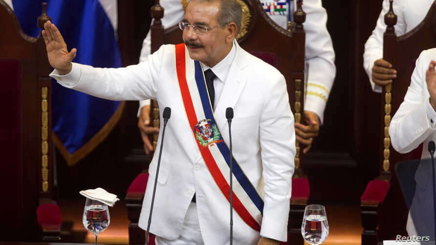 Dominican Republic President Danilo Medina waves during the swearing-in ceremony at the National Congress in Santo Domingo, Aug. 16, 2016.