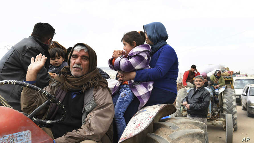 This photo released on March 7, 2018 by the Syrian official news agency SANA, shows Kurds fleeing from their villages where Turkish forces and Syrian rebels battle against Kurdish fighters, in Afrin, northern Syria.