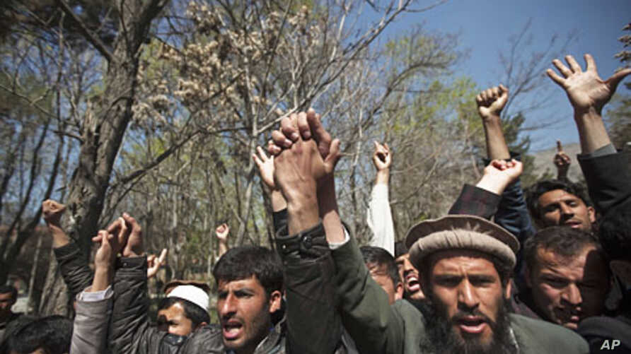 In Kabul, students shout anti-U.S. slogans during a protest against the burning of a Koran supervised by Florida-based militant fundamentalist Christian preacher, April 5, 2011