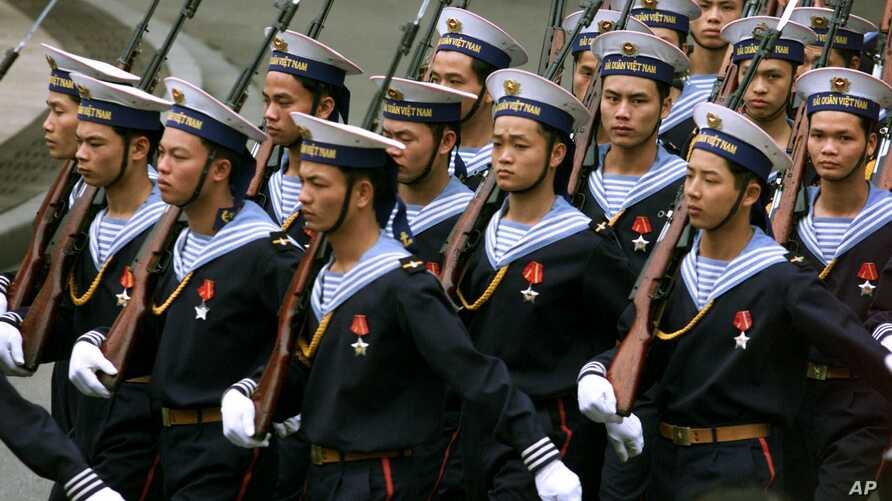 FILE -  Vietnamese sailors march in front of the Presidential Palace in Hanoi Thursday, March 1, 2001, in preparation for a visit by Russian President Vladimir Putin.  Among the topics Putin is expected to discuss is Moscow's leasing of Cam Ranh Bay