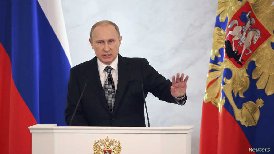 Russia's President Vladimir Putin delivers his annual state of the union address to the Federal Assembly at the Kremlin in Moscow, Dec. 4, 2014.
