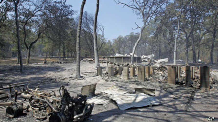 A pier foundation and pool are among the remains of a home destroyed when a wildfire swept through Bastrop, Texas, September 6, 2011.