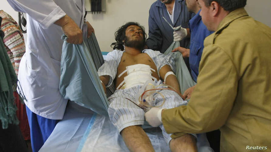 Medics treat a man, who was wounded during a suicide attack at a volleyball match on Sunday in the Yahya Khail district of Paktika province, at a military hospital in Kabul, Nov. 24, 2014