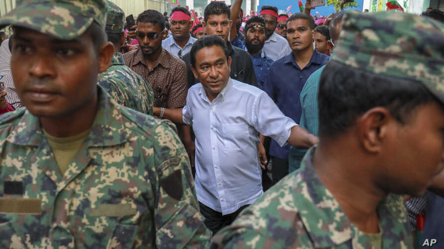 FILE - Maldivian President Yameen Abdul Gayoom, center, surrounded by his body guards arrives to address his supporters in Male, Maldives, Feb. 3, 2018.
