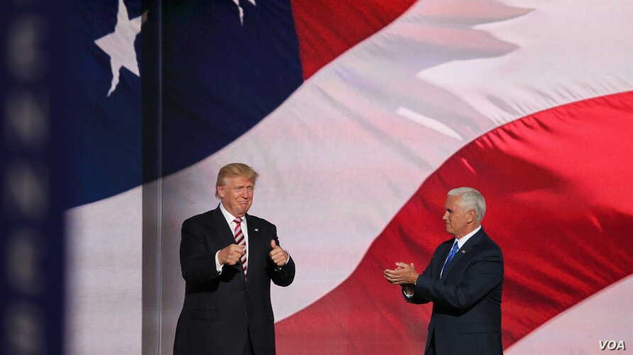 Republican presidential nominee Donald Trump, left, gives his running mate, Indiana Governor Mike Pence, a thumbs up after Pence addressed the Republican National Convention.