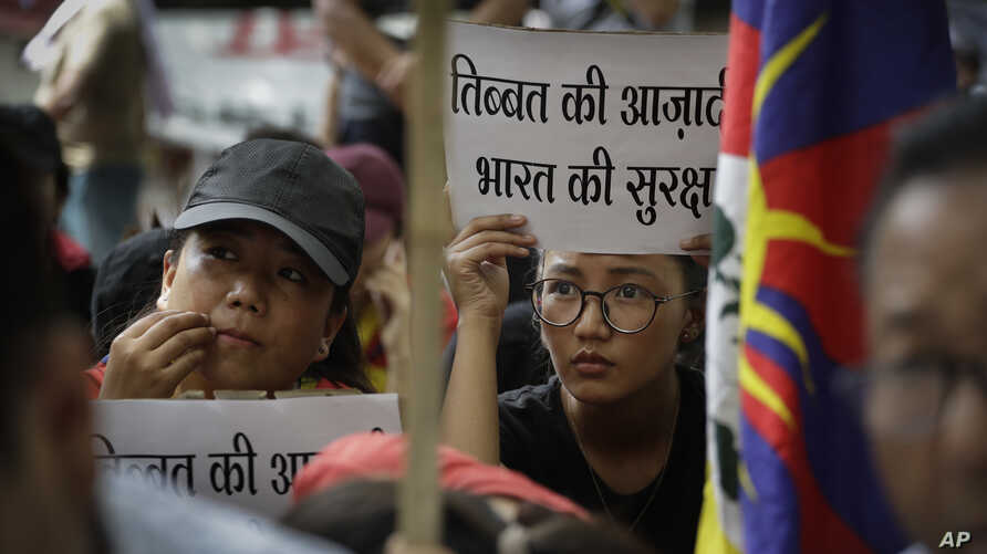 Exile Tibetans listen to a speaker during a protest to show support with India Doklam standoff in New Delhi, India, Aug. 11, 2017.