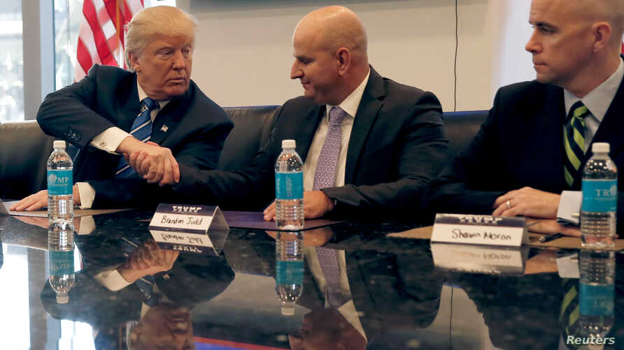 FILE - Donald Trump, Republican presidential nominee at the time, shakes hands with Brandon Judd, President of the National Border Patrol Council while receiving the group's endorsement during a meeting at Trump Tower in New York, Oct. 7, 2016.