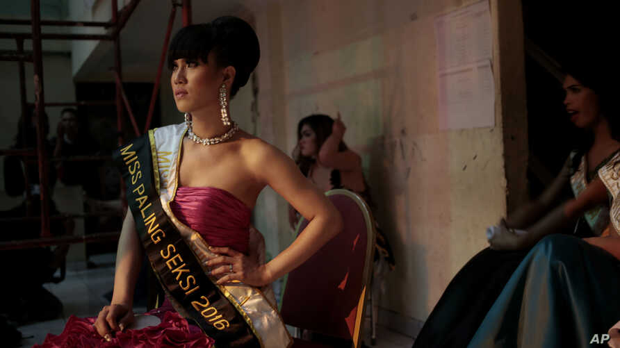 FILE - In this  Nov. 11, 2016 photo, contestants wait backstage during the Miss Transgender Indonesia pageant in Jakarta, Indonesia.