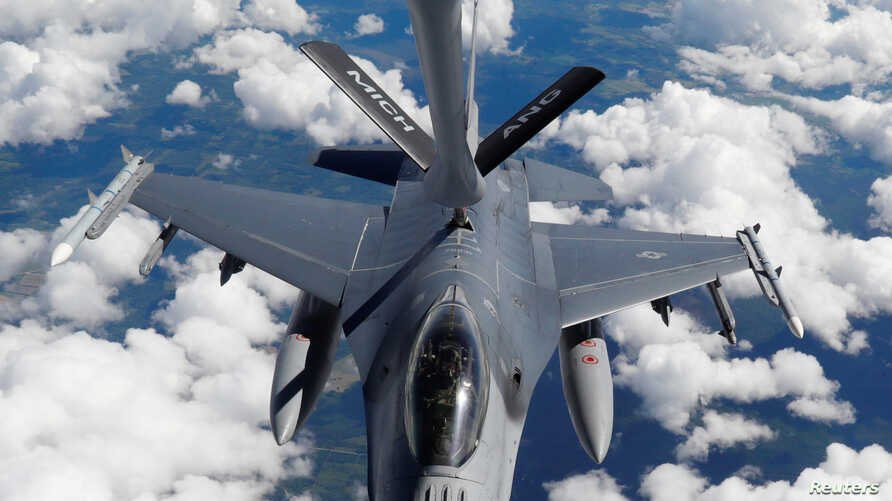A U.S. Air Force KC-135 aerial refueling aircraft refuels an F-16 fighter during the U.S. led Saber Strike exercise in the air over Estonia, June 6, 2018.