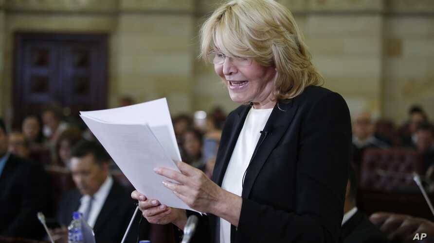 Former Venezuelan Chief Prosecutor Luisa Ortega shows documents that she claims prove that Venezuela's President Nicolas Maduro took bribes for the Brazilian construction company Odebrect, in Bogota, Colombia, April, 3, 2018.
