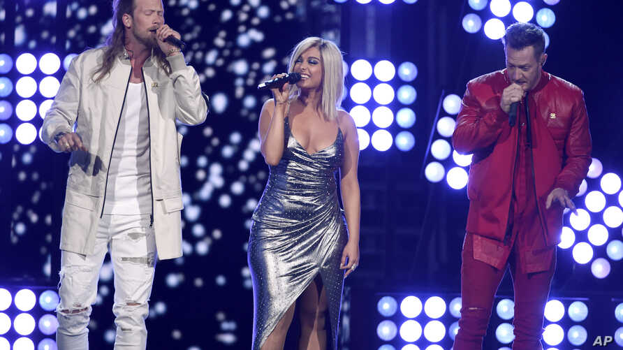 "FILE - Tyler Hubbard, right, and Brian Kelley, left, of Florida Georgia Line, and Bebe Rexha, center, perform ""Meant to Be"" at the 53rd annual Academy of Country Music Awards at the MGM Grand Garden Arena in Las Vegas."