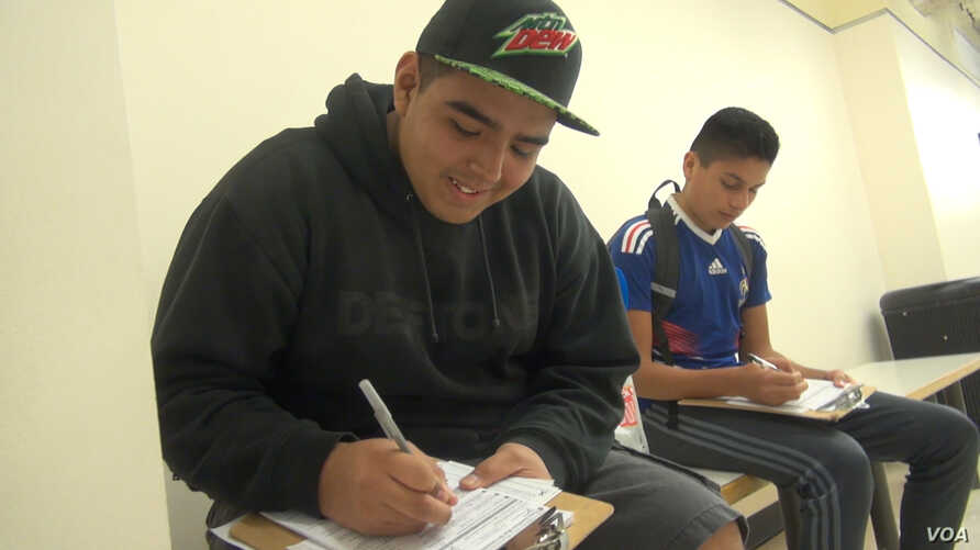 Two Hispanic men register to vote earlier this year in Houston. (G. Flakus/VOA)