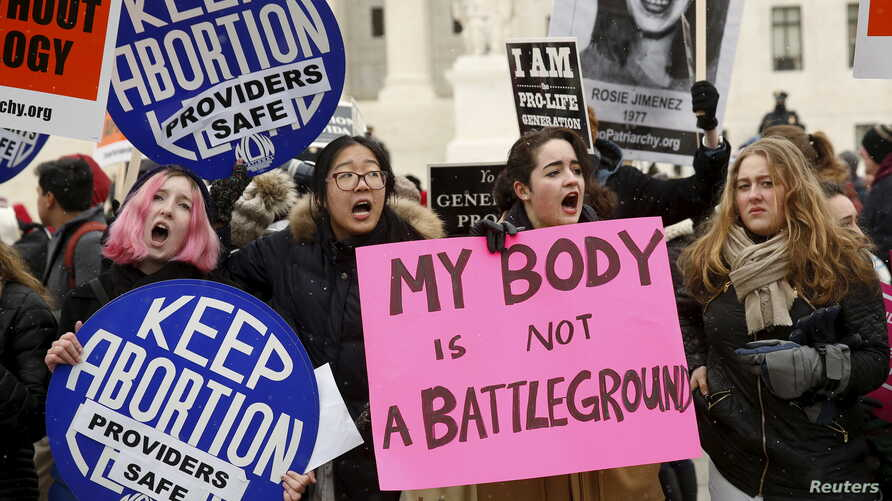 FILE - Pro-choice supporters demonstrate in front of the U.S. Supreme Court during the National March for Life rally in Washington, Jan. 22, 2016. The rally marks the 43rd anniversary of the U.S. Supreme Court's 1973 abortion ruling in Roe v. Wade.
