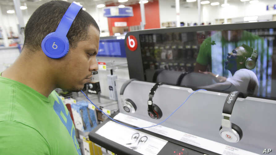 FILE - Eric Soriano listens to music with a pair of Beats headphones.