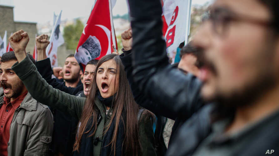Members of Turkey Youth Union shout anti-US slogans as they protest against the upcoming visit of the US President Barack Obama to Turkey mid-November for a G20 summit in Antalya, outside the US consulate in Istanbul, Turkey, Sunday, Nov. 8, 2015.
