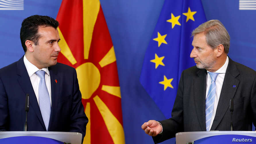 Macedonian Prime Minister Zoran Zaev and European Neighbourhood Policy and Enlargement Negotiations Commissioner Johannes Hahn, right, address a joint news conference after their meeting at the EU Commission headquarters in Brussels, Belgium June 12,