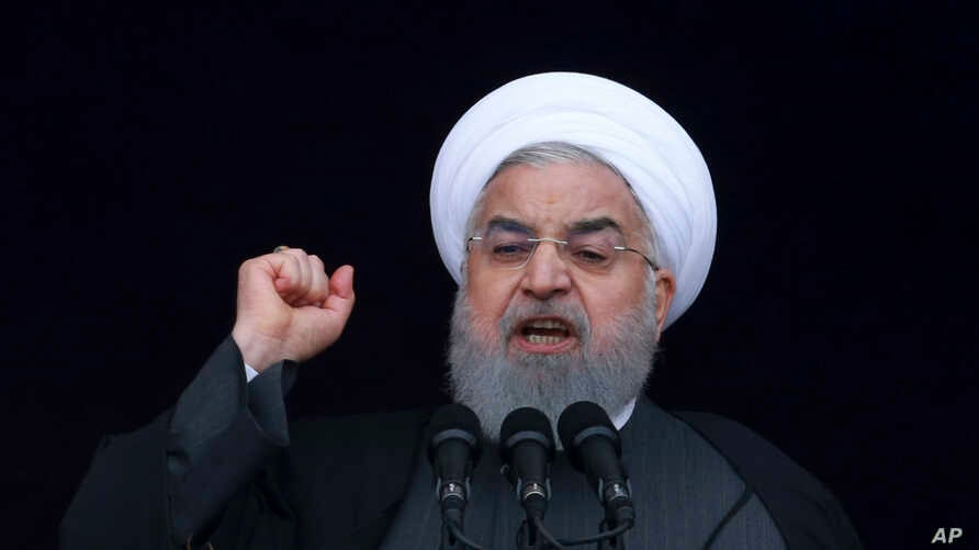 Iranian President Hassan Rouhani speaks during a ceremony celebrating the 40th anniversary of the Islamic Revolution, at the Azadi, Freedom, Square in Tehran, Feb. 11, 2019.