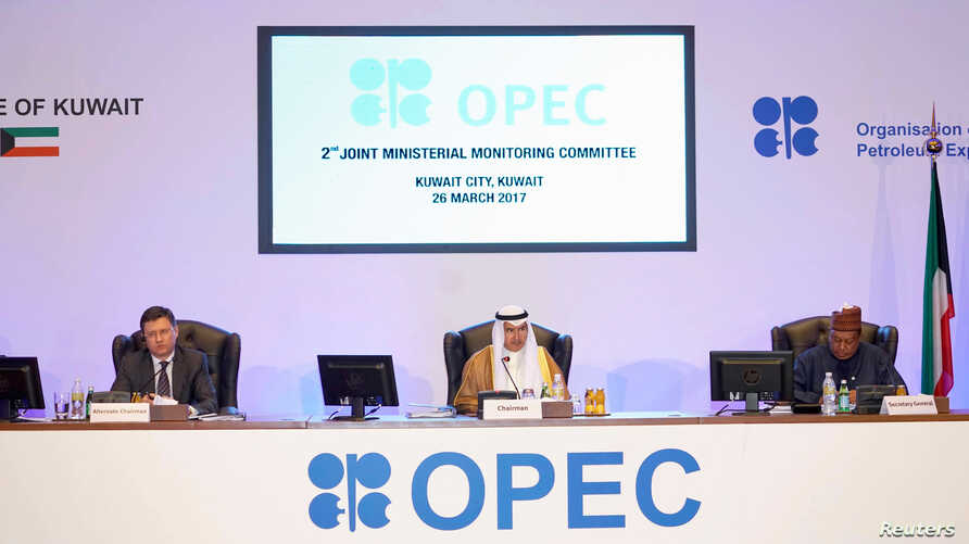 Kuwait Oil Minister Ali Al-Omair gives his opening speech during OPEC 2nd Joint Ministerial Monitoring Committee meeting as Russian Energy Minister Alexander Novak and OPEC Secretary-General Mohammad Barkindo attend the meeting in Kuwait City, Kuwait
