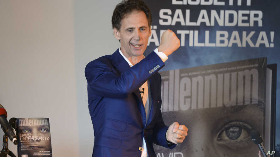 FILE - David Lagercrantz talks to media at a release event for the fourth book in the Millenium series of crime novels in Stockholm, Aug. 26, 2015.