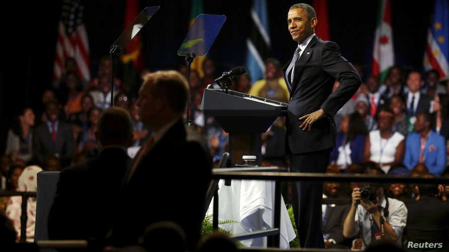U.S. President Barack Obama playfully mimics the arms-akimbo stance of a young woman who asked a question during a town hall session at the Young African Leaders Initiative (YALI) Mandela Washington Fellowship Presidential Summit in Washington, Aug.