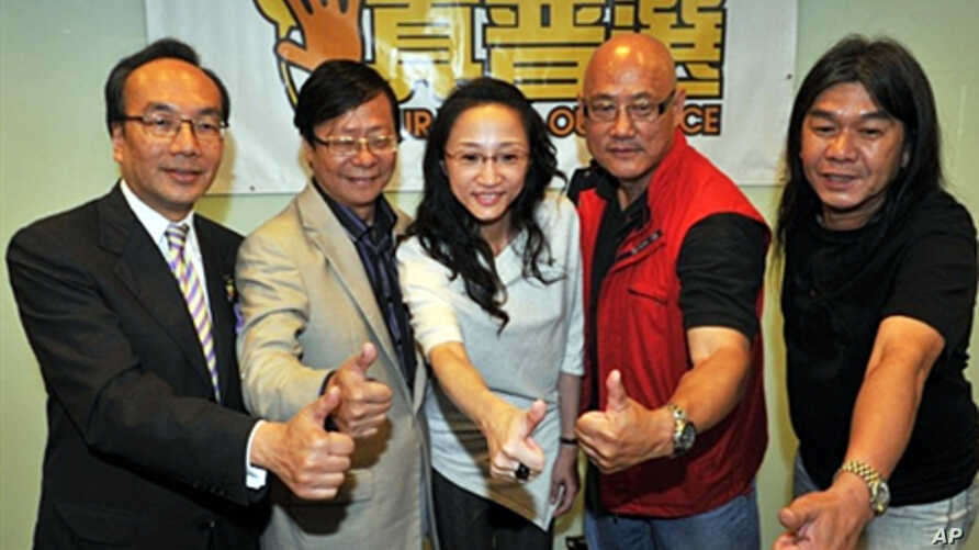 Members of League of Social Democrats pose during a post by-election press conference in Hong Kong, 17 May 2010