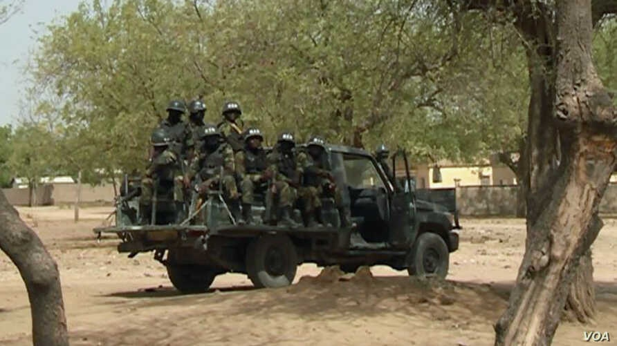 FILE - Soldiers of the Rapid Intervention Battalion patrol in Maroua, far northern Cameroon, Jan. 17 2019.